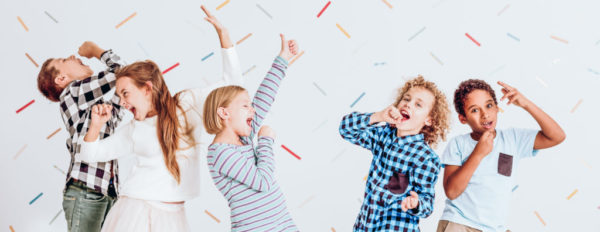 Kids pretending to sing